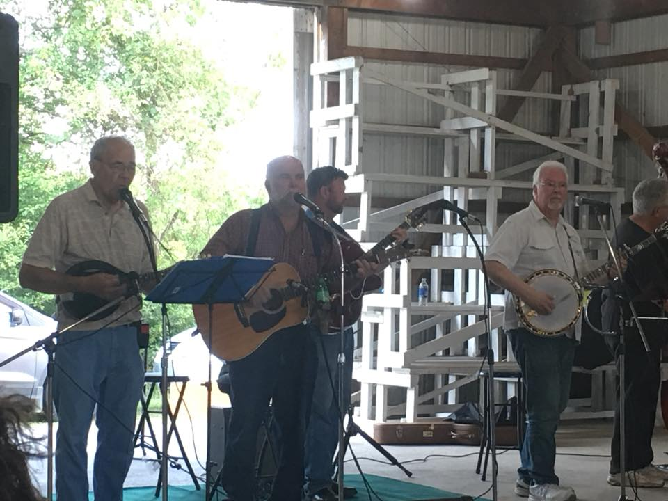 Group of guys playing bluegrass music in a garage